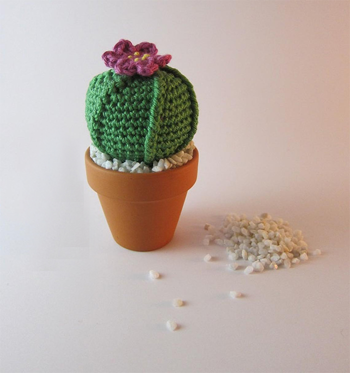 crocheted faux plant with decorative pebbles